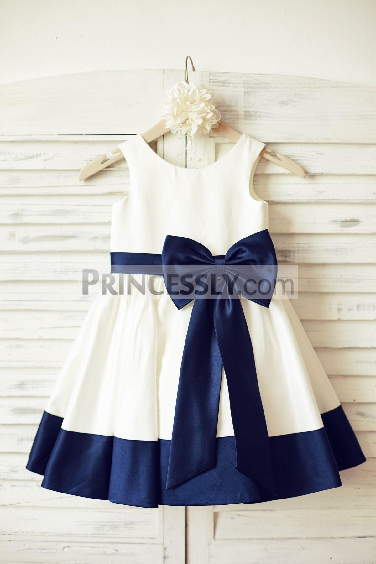 Ivory Satin Sleeveless Flower Girl Dress With Navy Blue Belt Bow