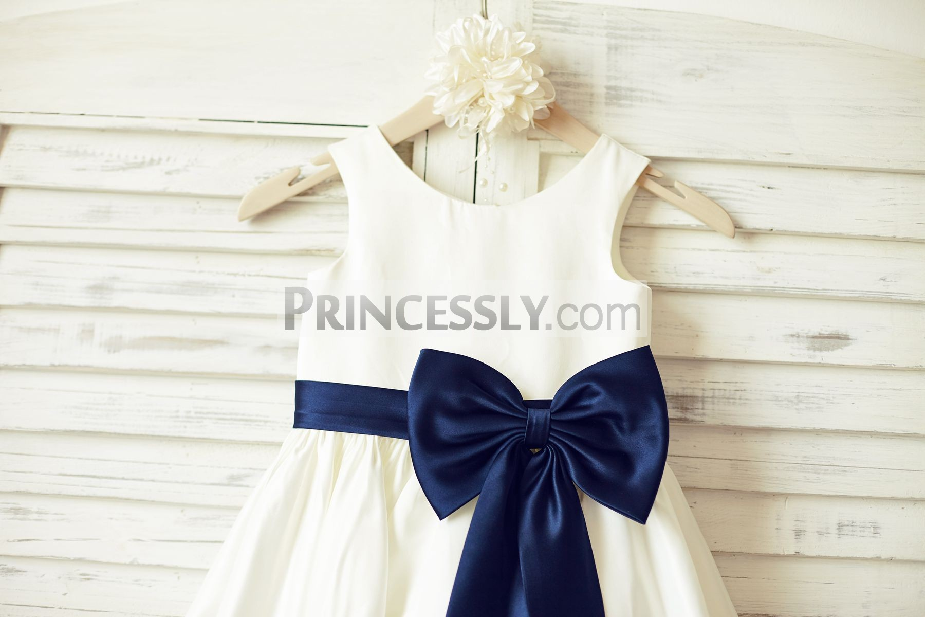 Ivory satin sleeveless flower girl dress with navy blue belt bow round neck sleeveless panel bodice with navy blue sash and bow izmirmasajfo