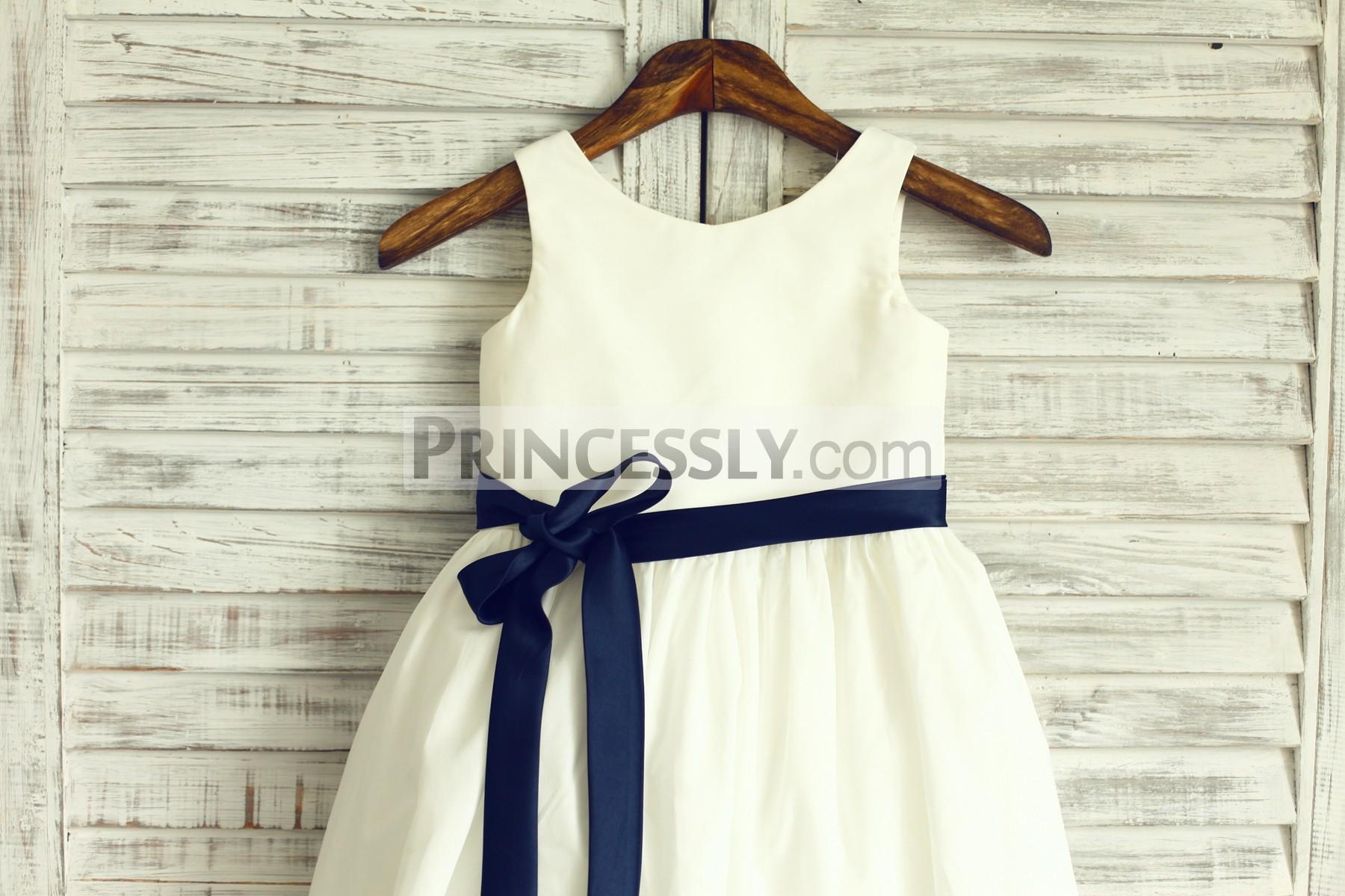 Sleeveless bodice with navy blue sash