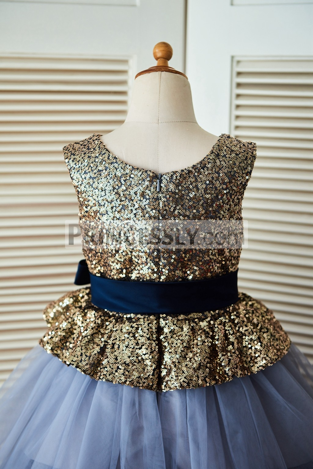 84ce34b12ba ... tulle cupcake wedding baby girl dress. Scoop neckline and sleeveless gold  sequin bodice with navy blue sash. Gold sequin bodice with zipper back