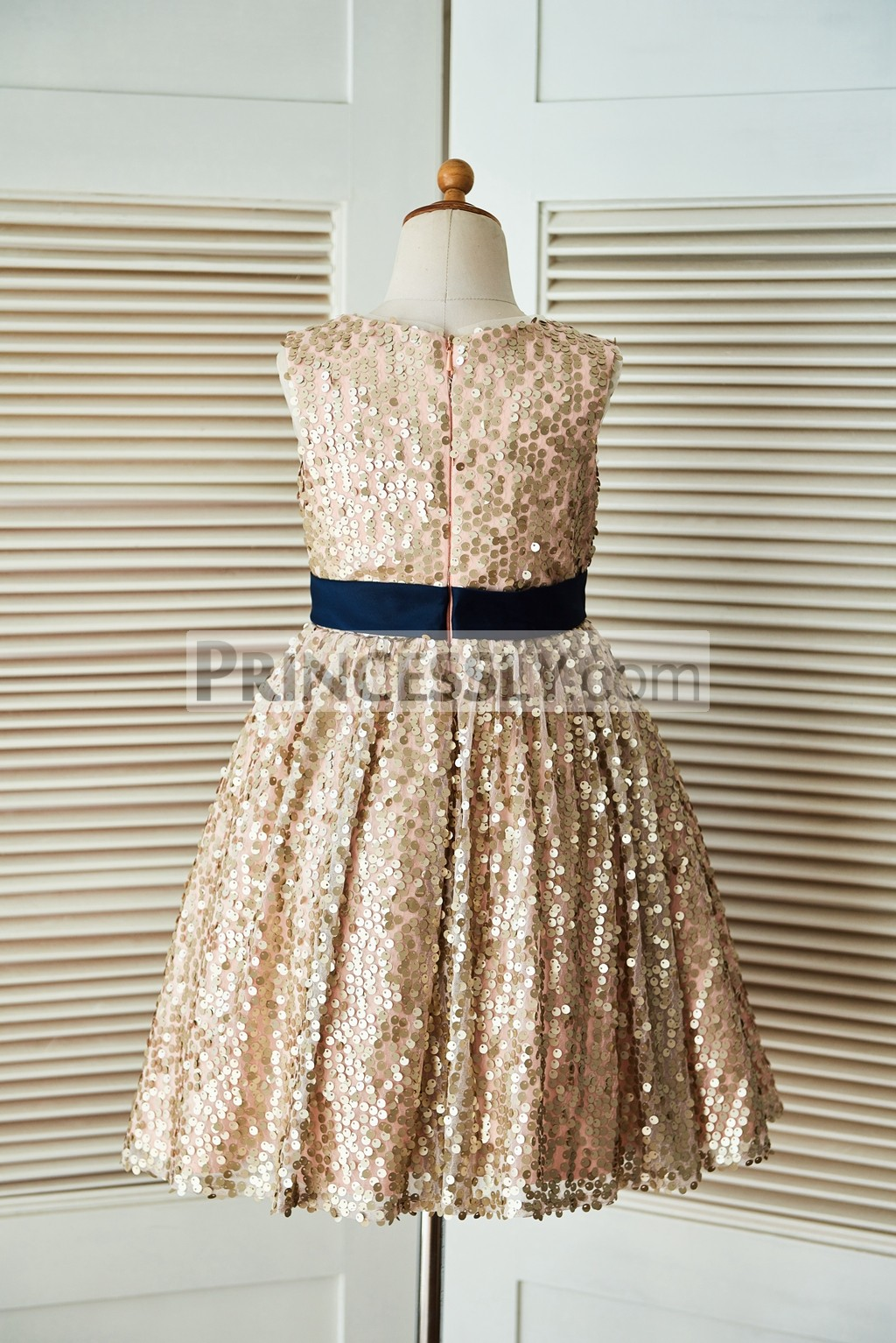 4c12143a33a Champagne Gold Sequin Flower Girl Dress with Navy Blue Belt and Bow ...