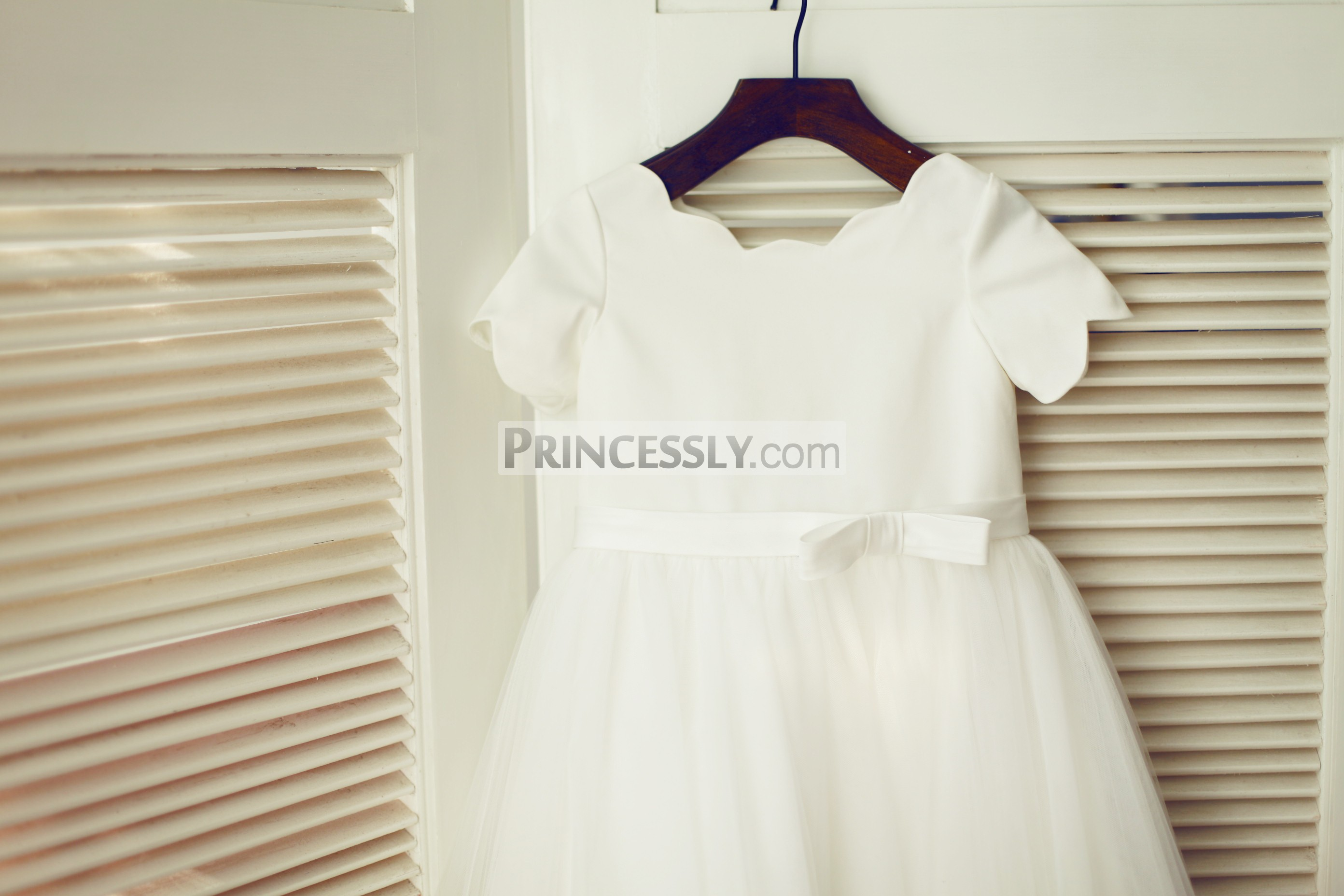 fa1d8a6d361 Ivory Satin Tulle Wedding Baby Girl Dress. Ivory satin panel bodice in  scalloped neckline and short sleeves