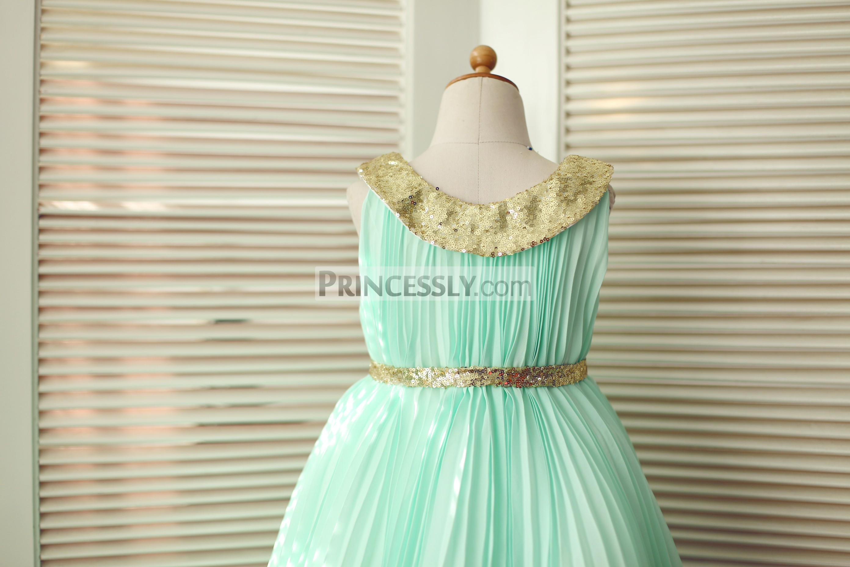 1c99eab4a28 ... tulle wedding baby girl dress. Gold sequin peter pan collar and belt.  Gold sequin neck and belt for the whole mint green pleated dress
