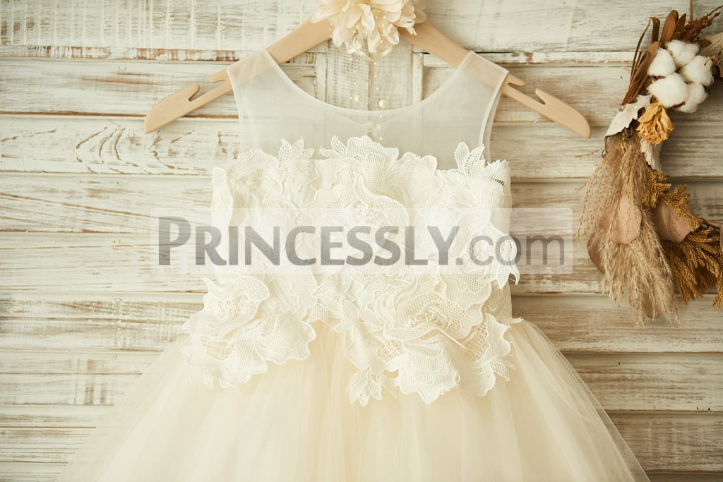 Ivory cotton lace applique bodice with sheer scoop neckline and sleeveless