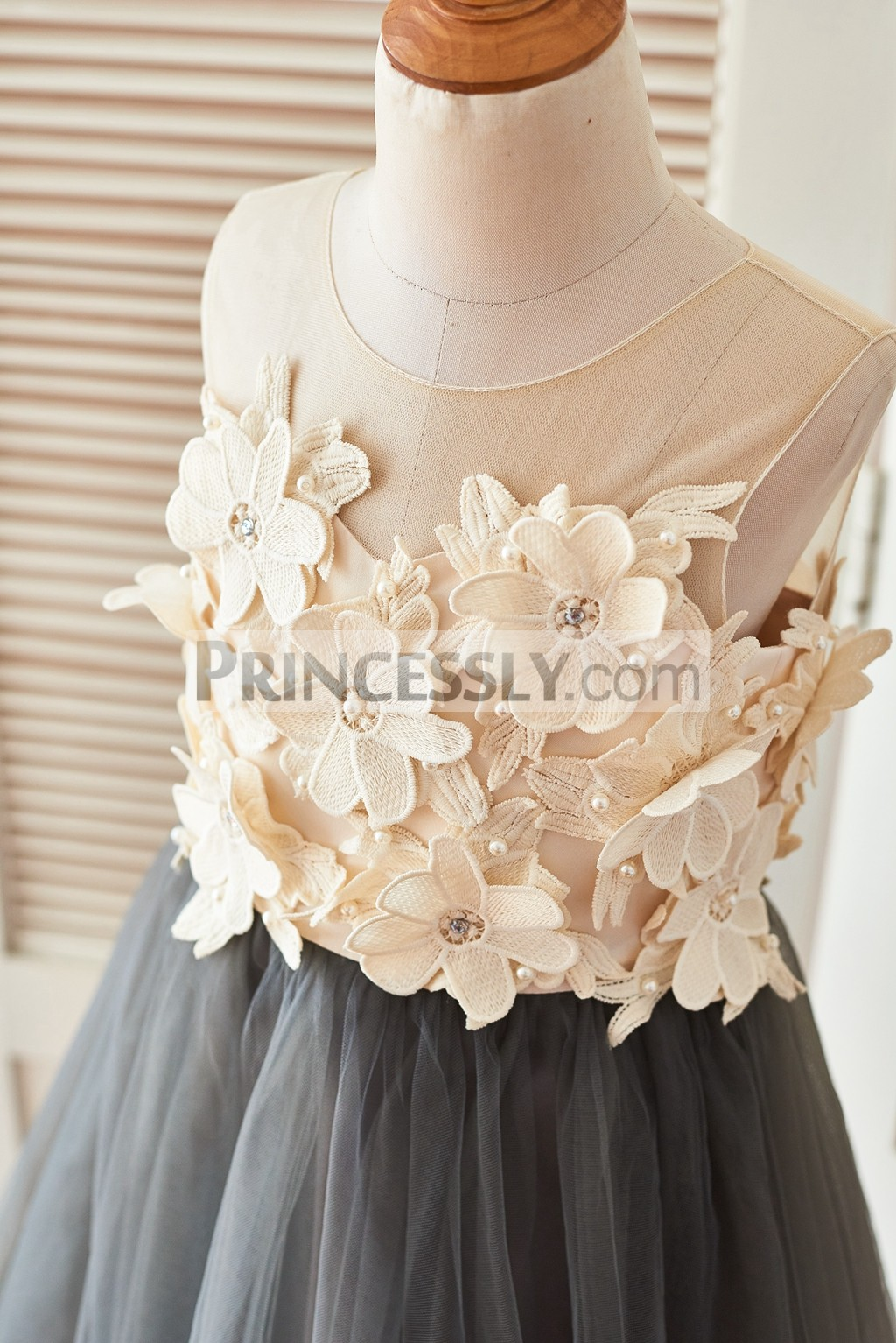 Sheer bodice with beaded 3D flowers in round neckline and sleeveless style
