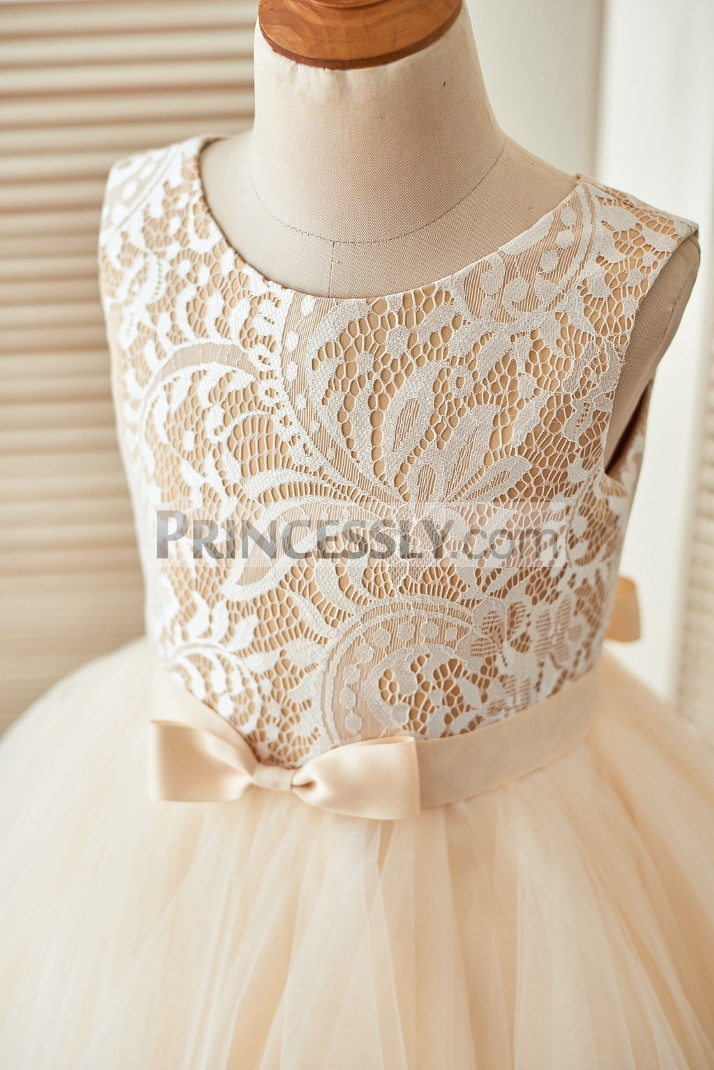 Ivory lace bodice in scoop neckline and sleeveless with satin belt and bow