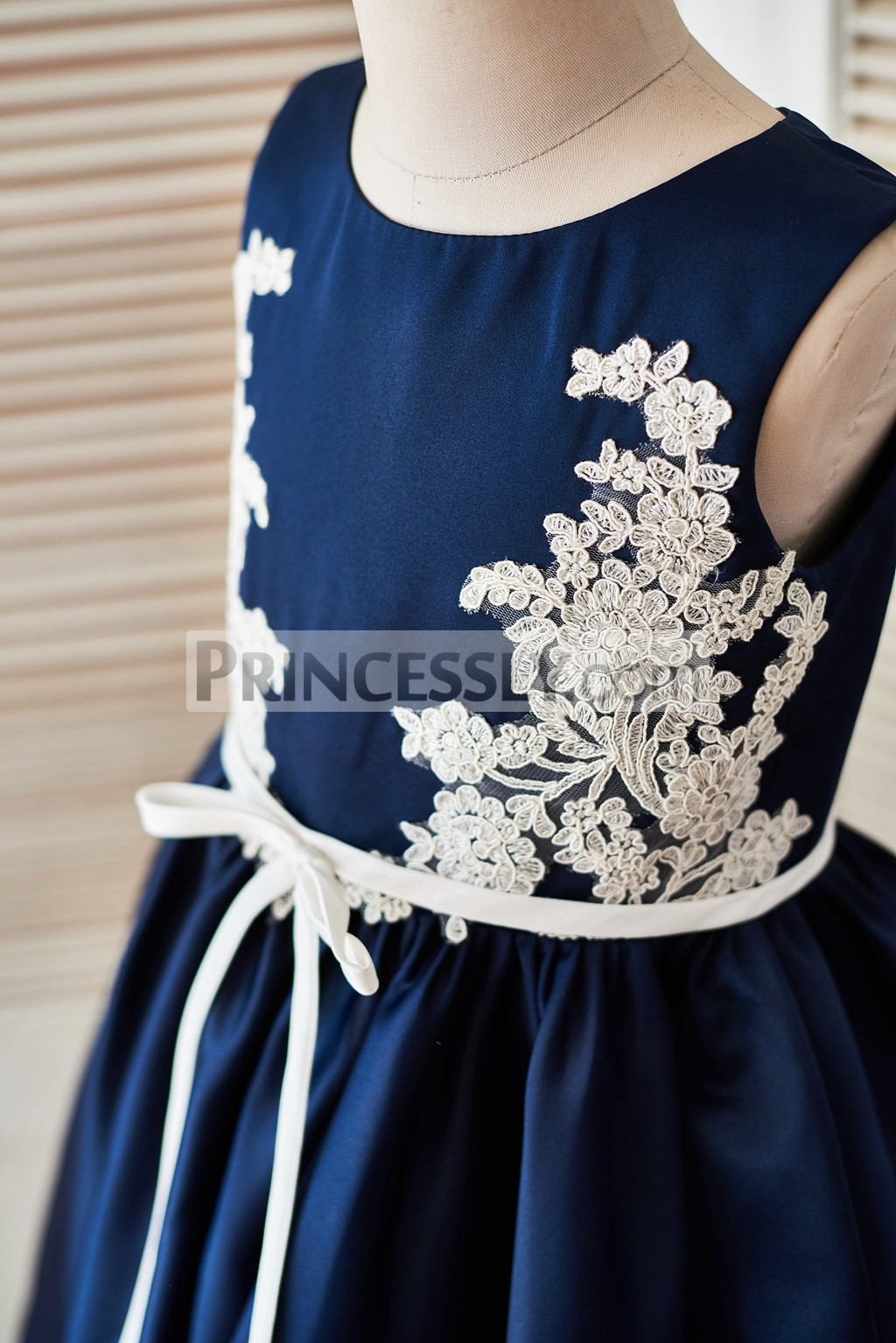 Ivory lace appliques on both of side bodice with a sash