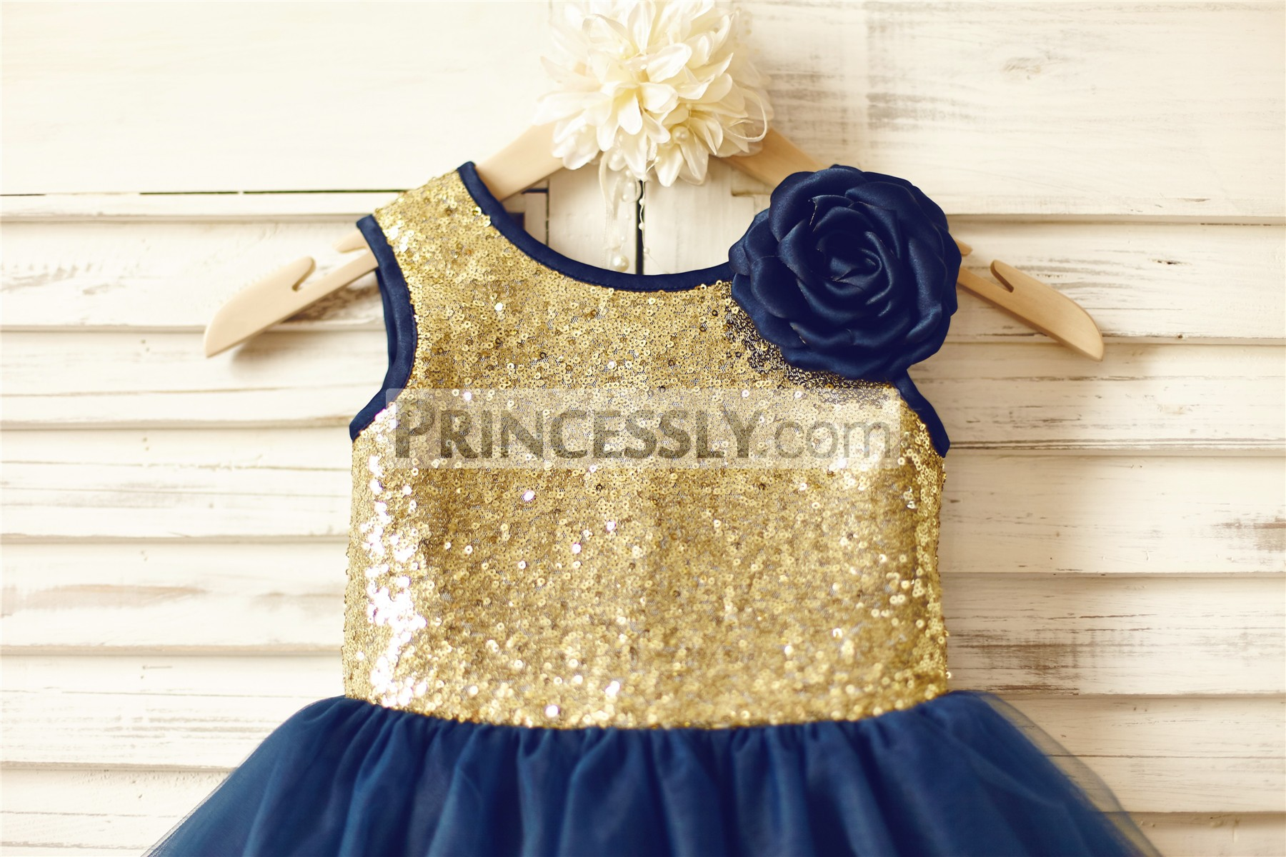 Gold sequins bodice with navy blue satin edged scoop and arm holes