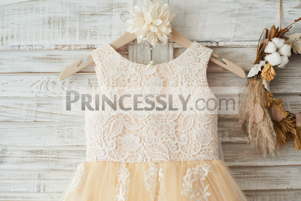 Scoop neckline sleeveless ivory floral lace bodice