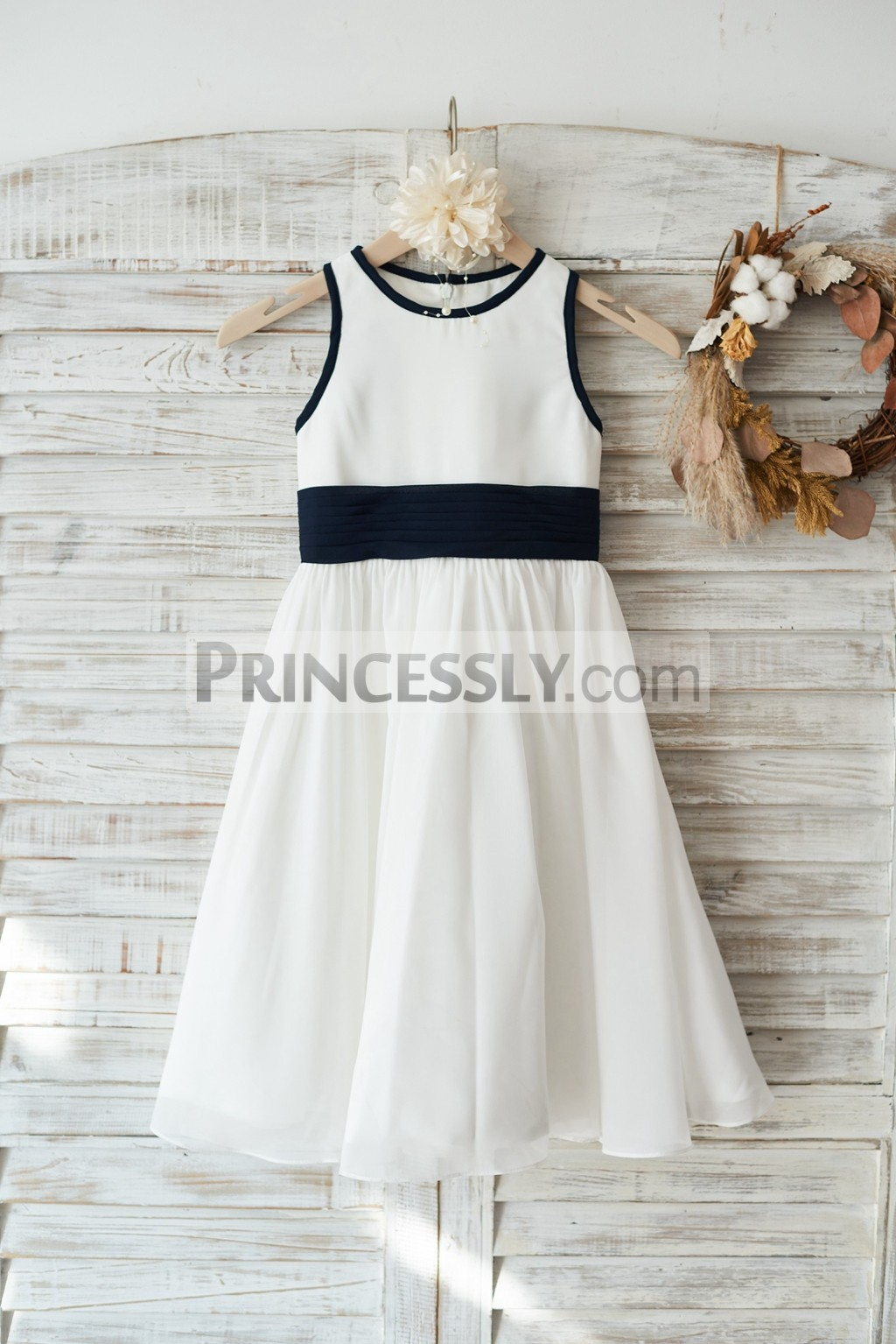 Ivory chiffon flower girl dress with navy blue edge and belt