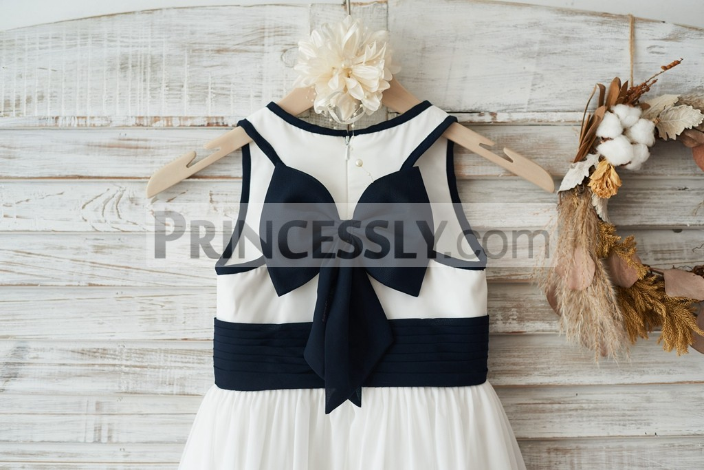 Racer back with big navy blue bow