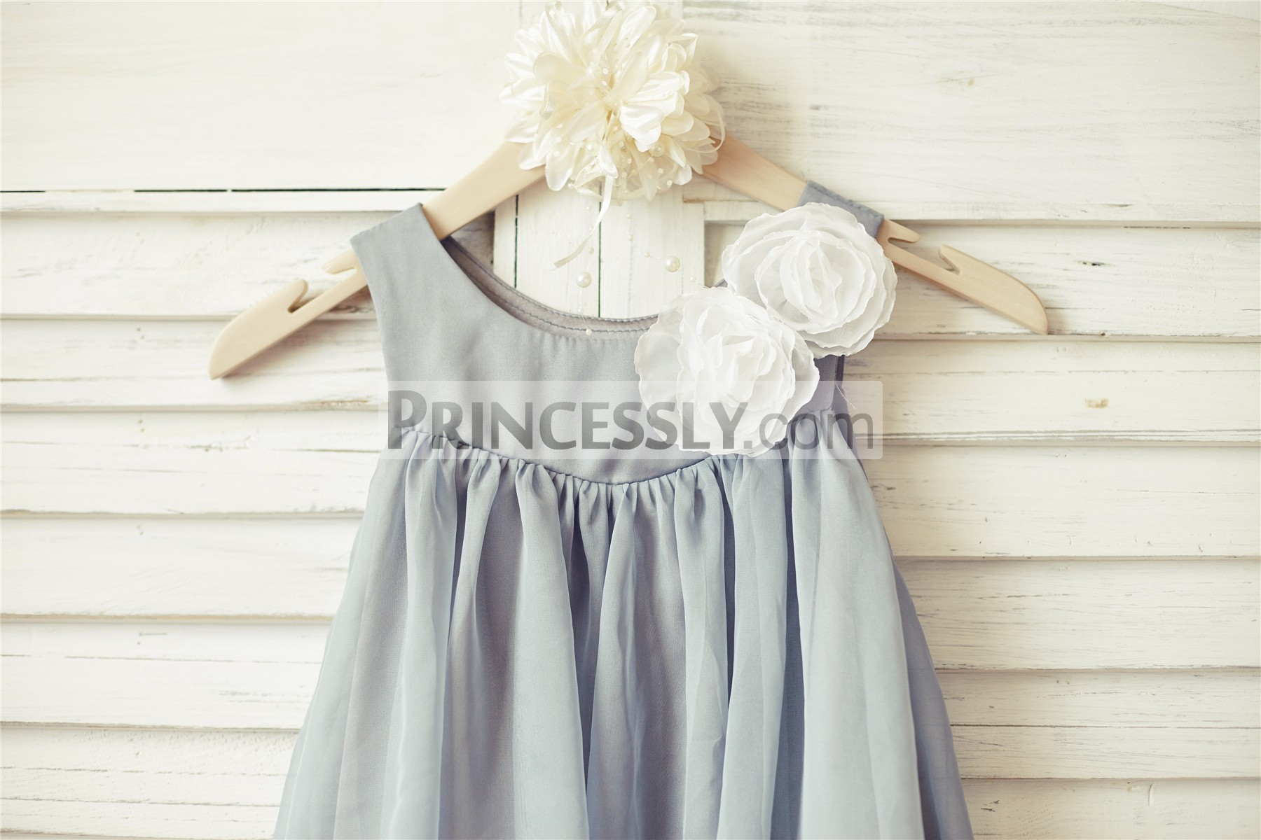 Scoop neckline sleeveless bodice with handmade ivory flowers