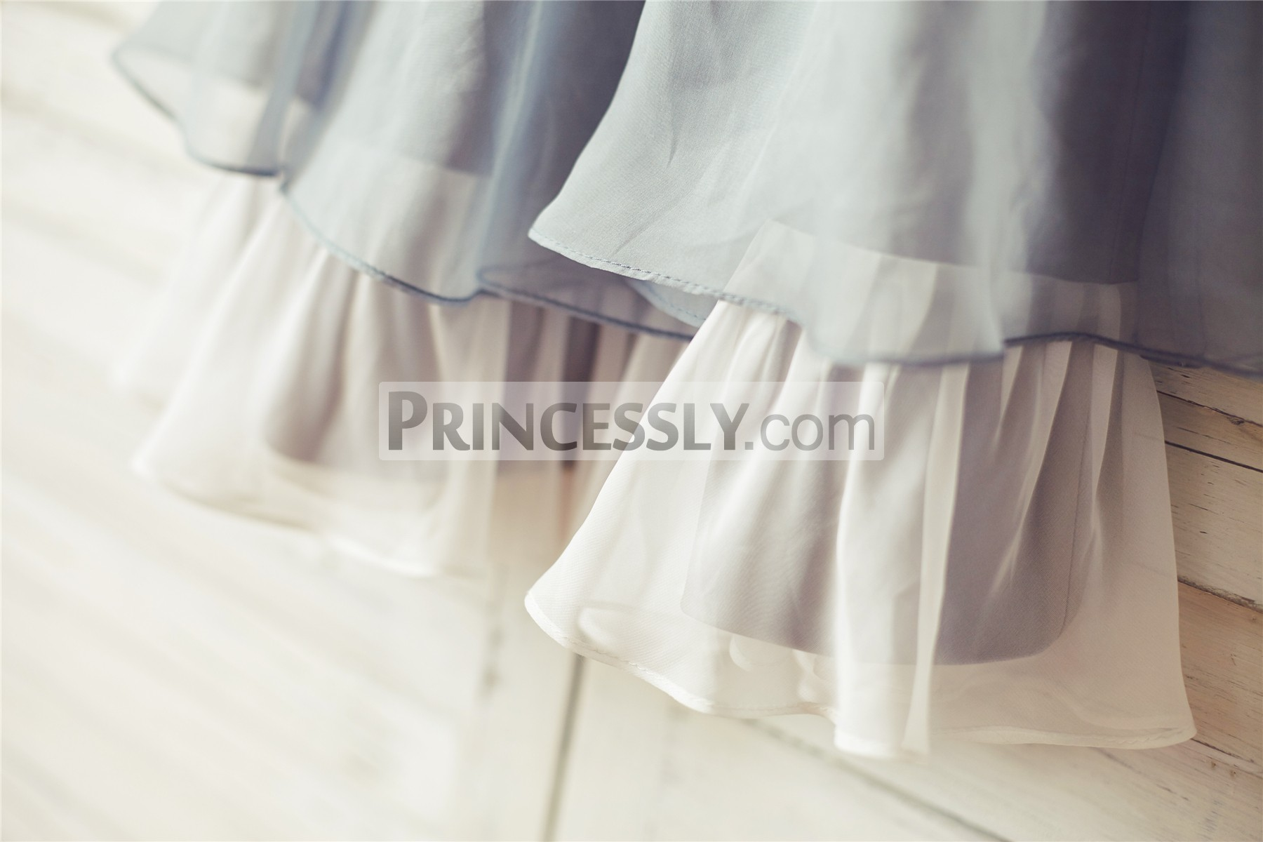 Ivory chiffon ruffled hem of layered skirt