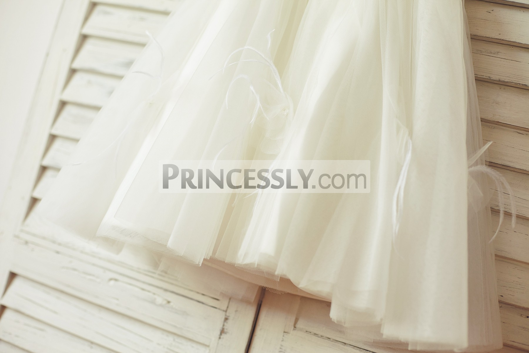 Small flowers & feathers embellished ivory tulle layered skirt
