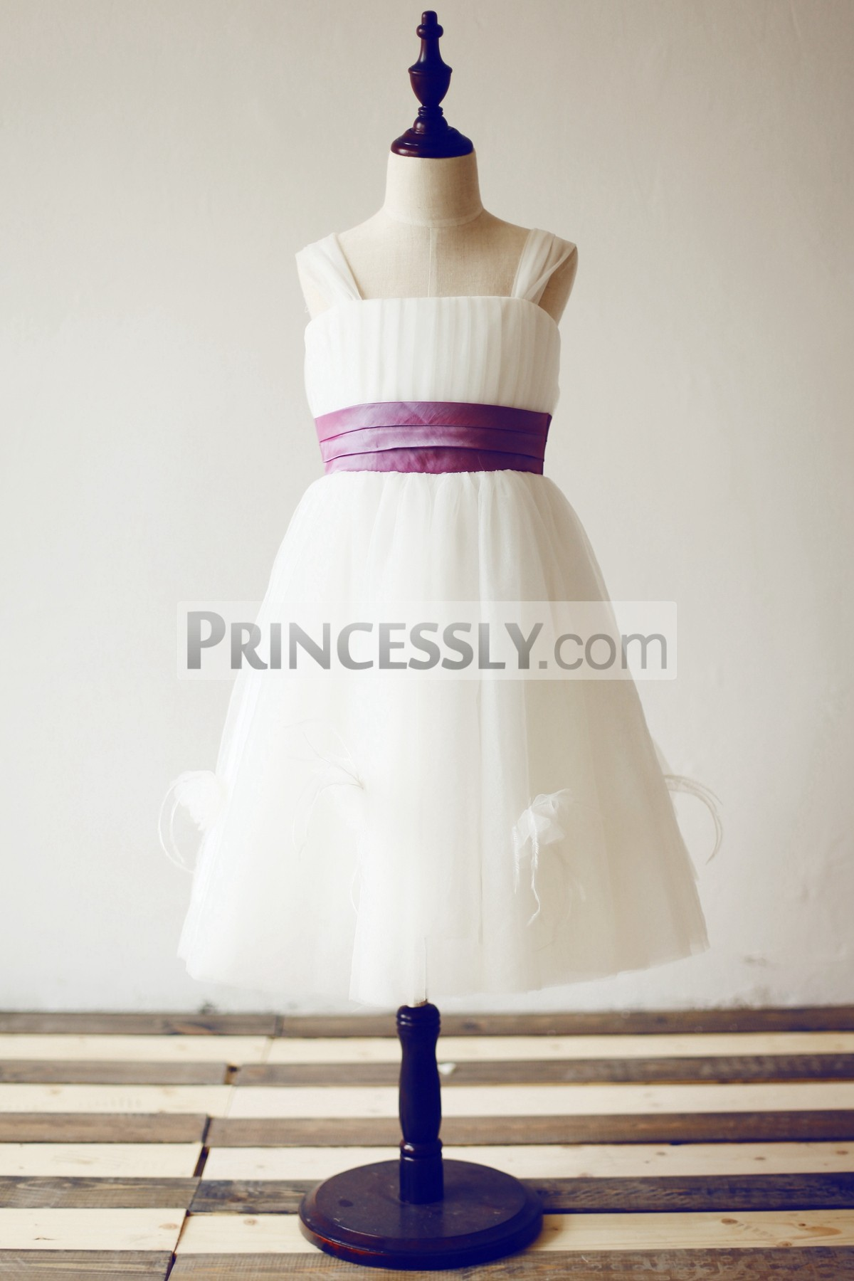 Ivory tulle flower girl dress with purple belt and feathers