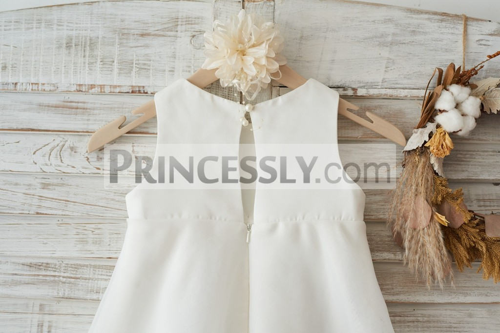 3289e3908 ... ivory satin organza wedding baby girl dress. Scoop neck and sleeveless  bodice with a bow. Slit back with a pearl