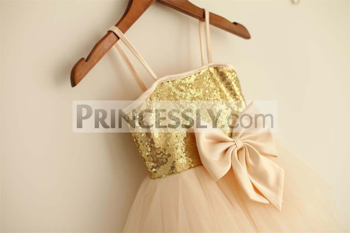 Gold sequined bodice with champagne satin straps and bow