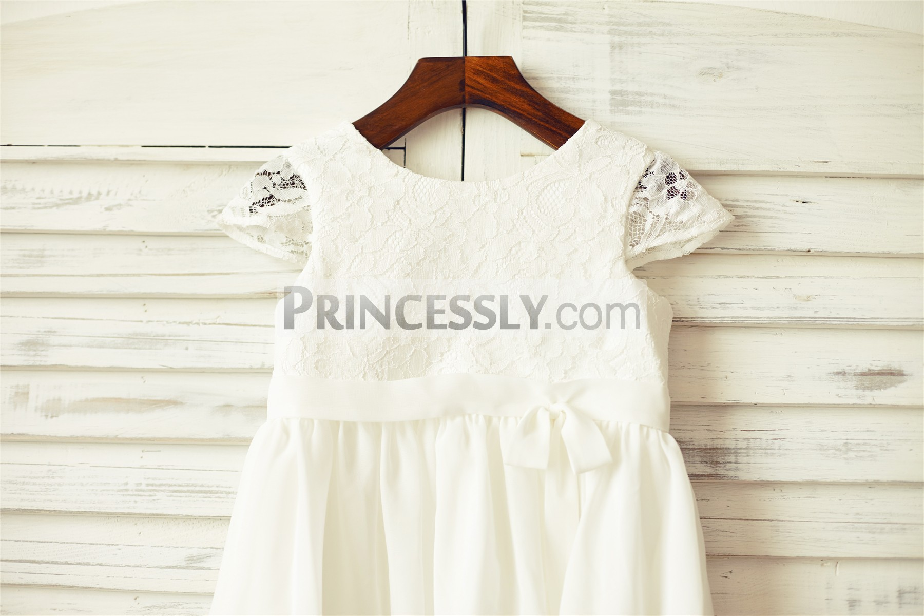 Scoop neckline sheer cap sleeves ivory lace bodice with belt bow
