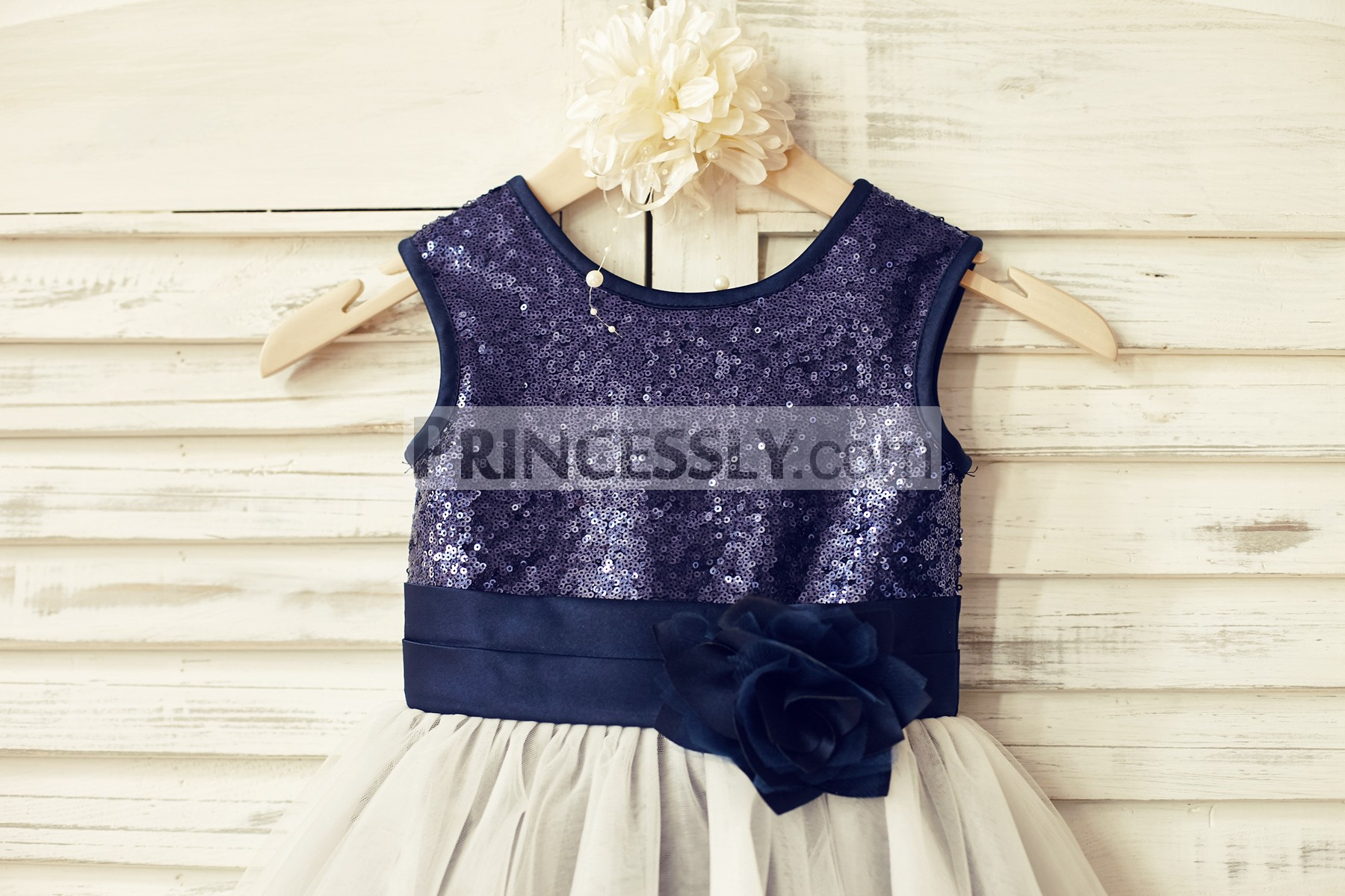 Navy blue sequin bodice with fixed belt and flower