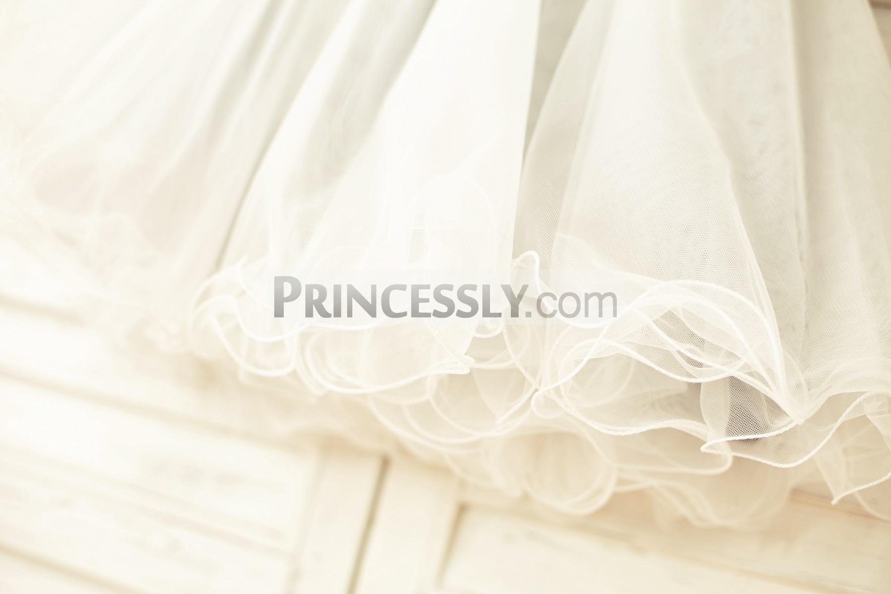 Ivory tulle skirt with curly hem