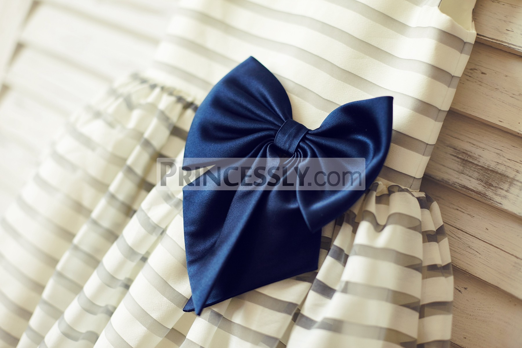 Pre-made navy blue taffeta bow at side waist