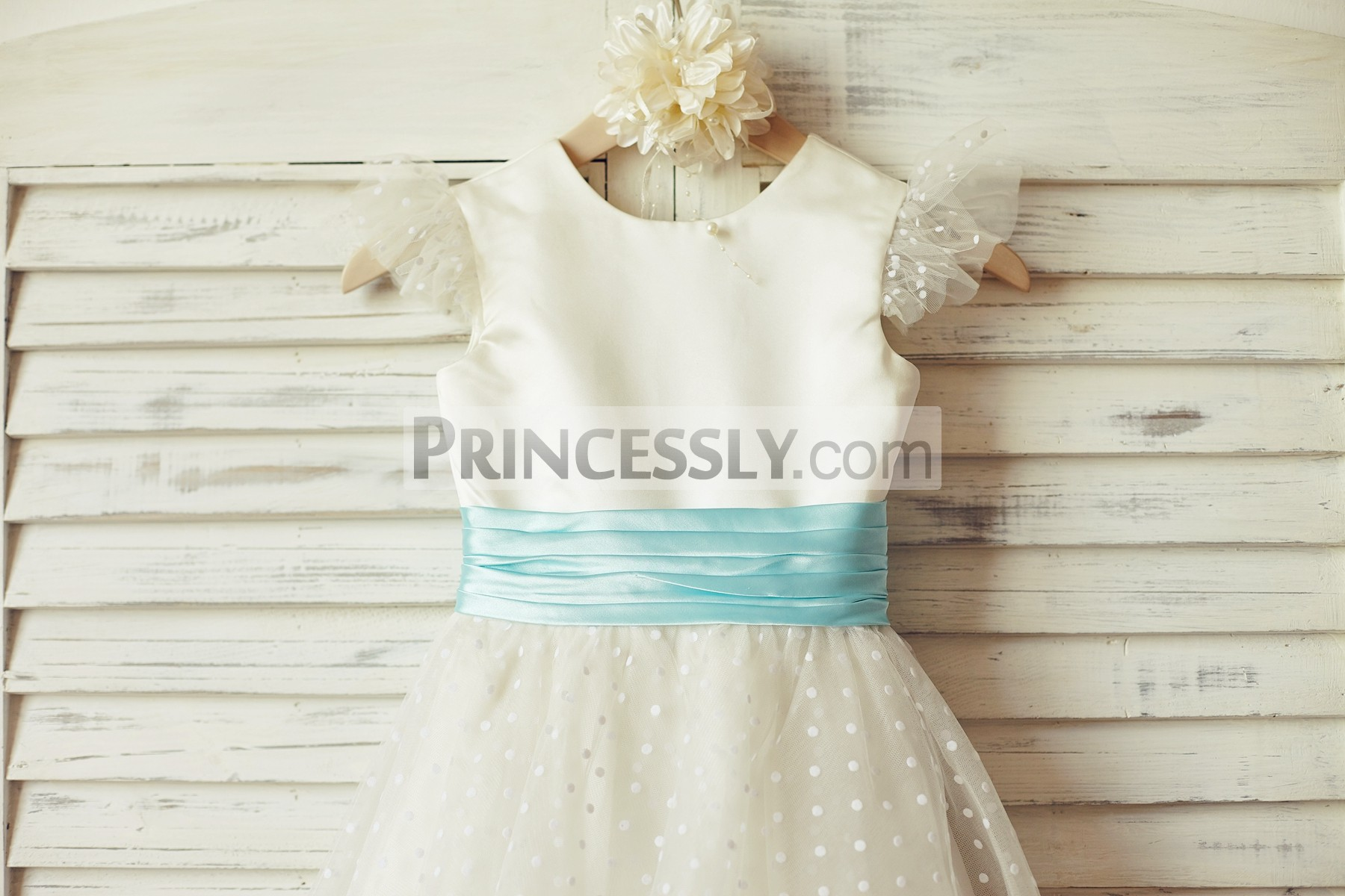 Dotted tulle cap sleeves ivory satin bodice with pleated blue sash
