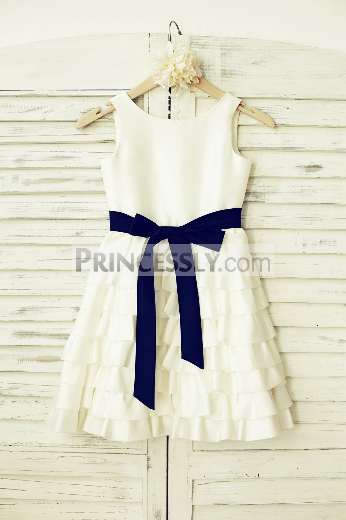 Ivory taffeta cupcake flower girl dress with navy blue sash