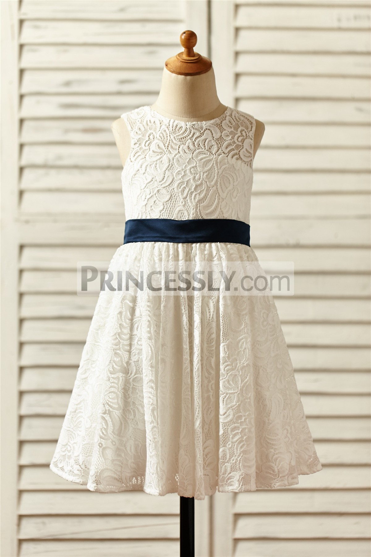 Ivory floral lace flower girl dress with navy blue belt