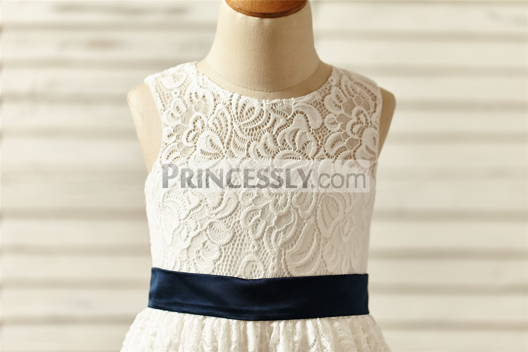 Jewel neckline sleeveless floral lace bodice with navy blue belt