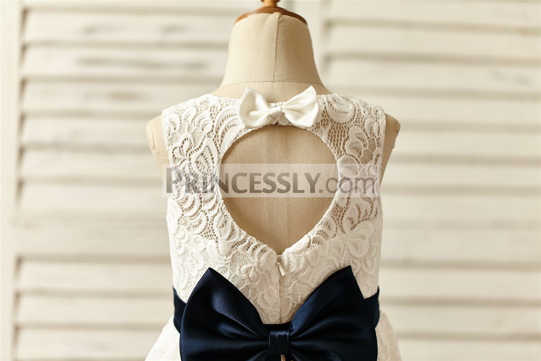 peach shaped cutout back with ivory small bow and big navy blue bow