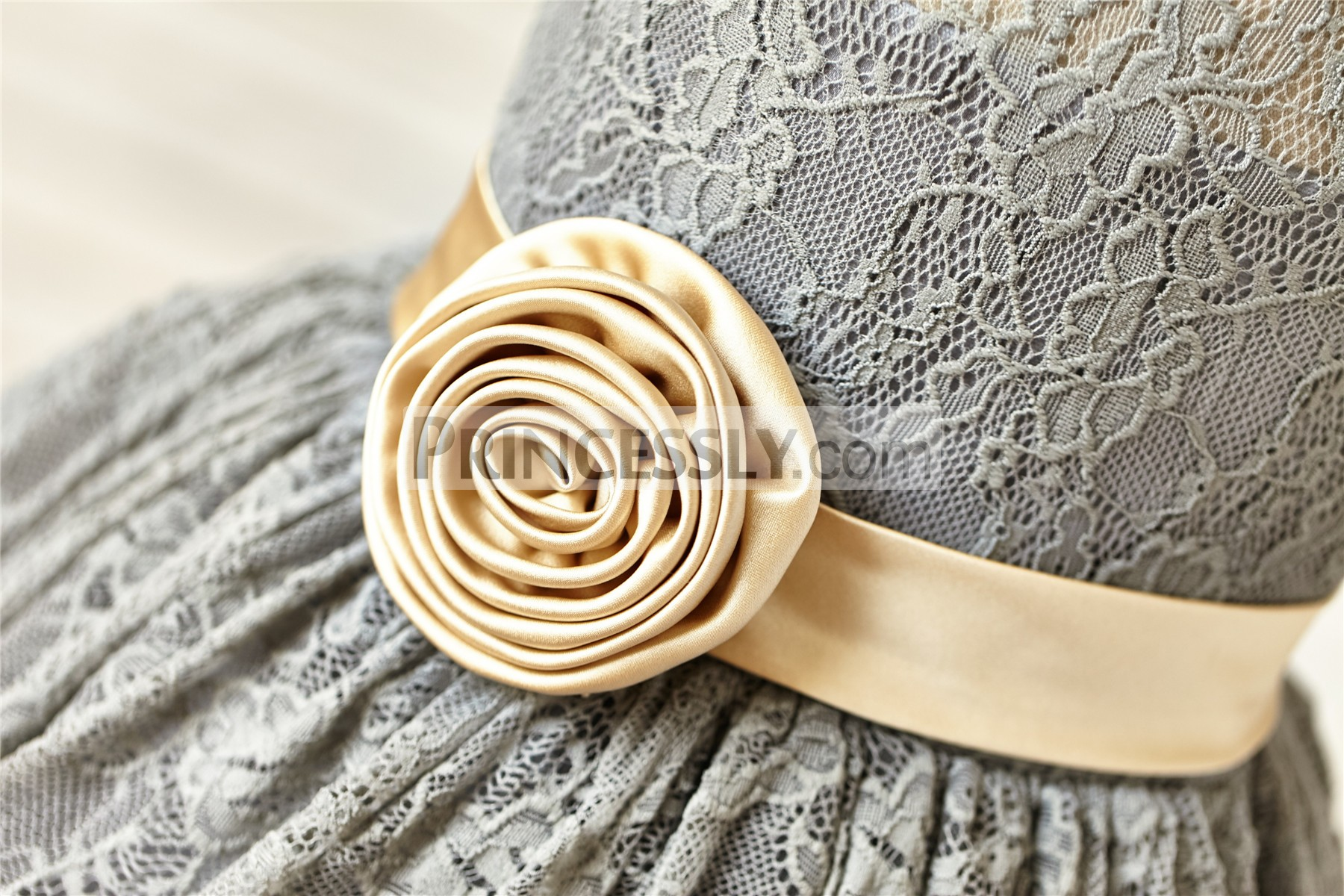 Champagne gathered flower on side of waist