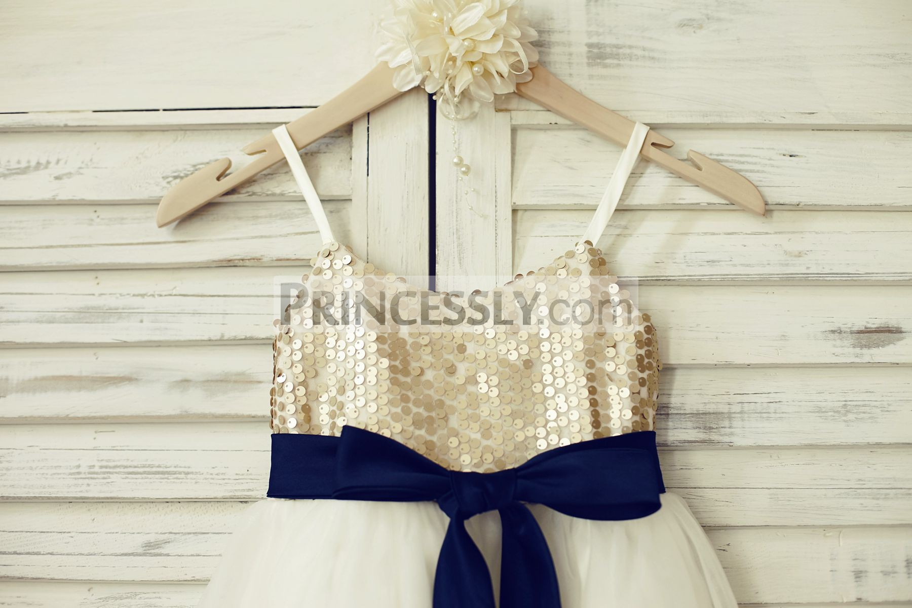 Spaghetti straps champagne sequins bodice with navy blue sash