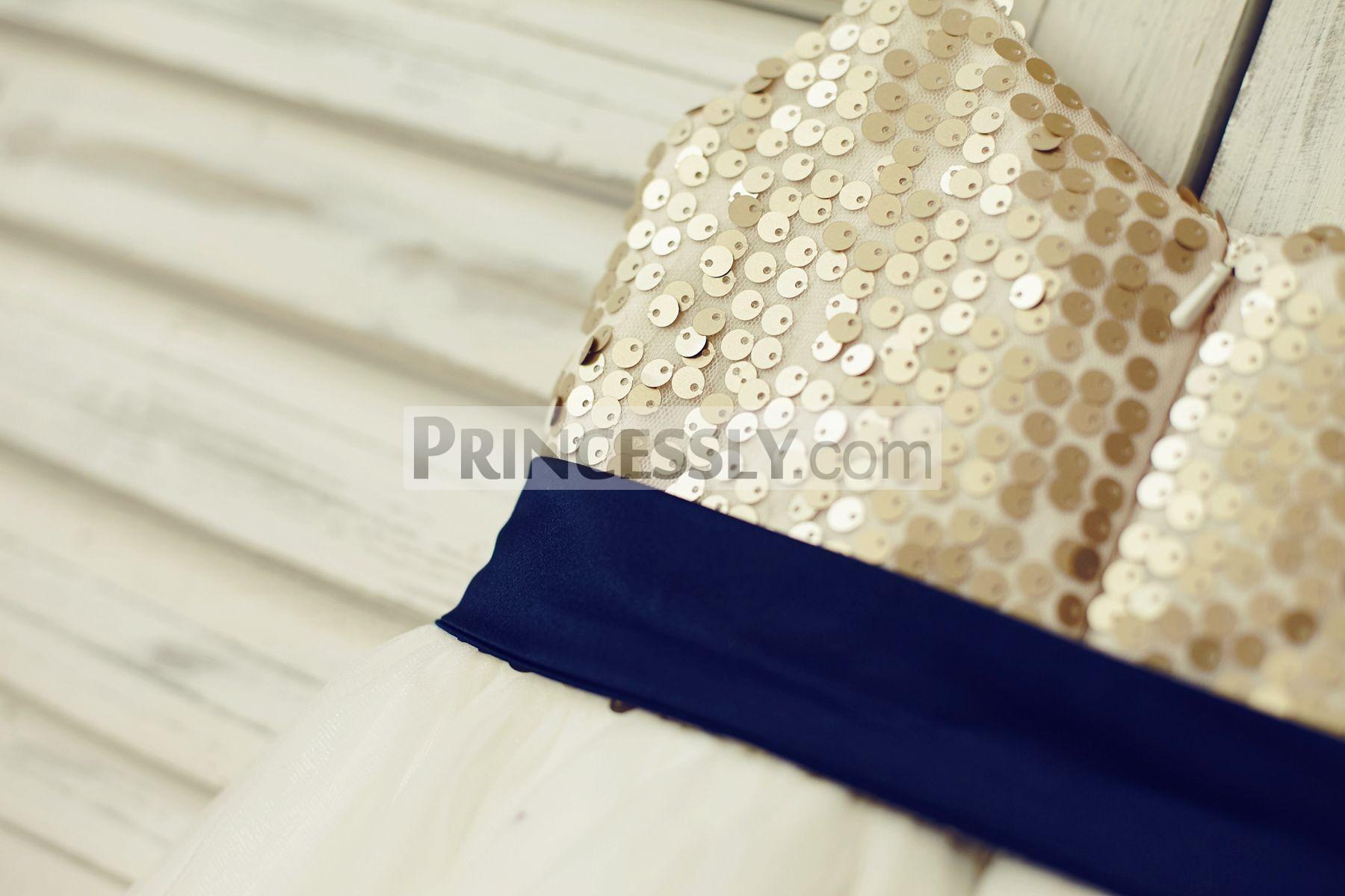 Detachable navy blue sash and zipper back