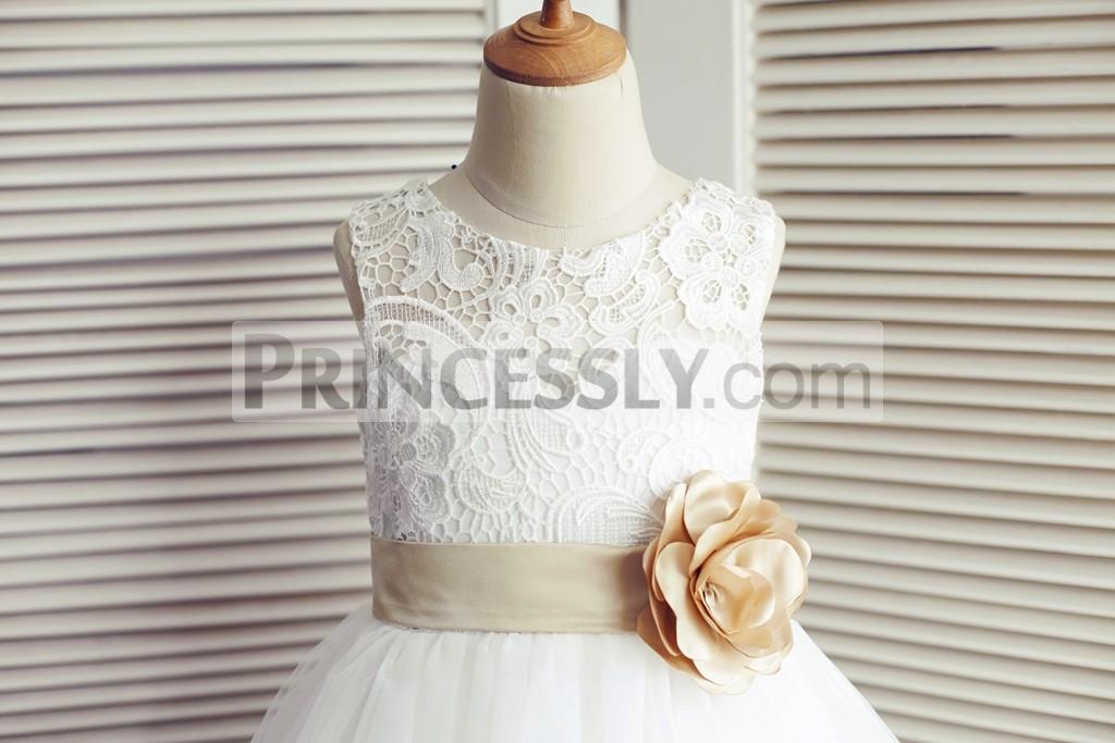 Scoop neckline sleeveless lace bodice with belt & flower