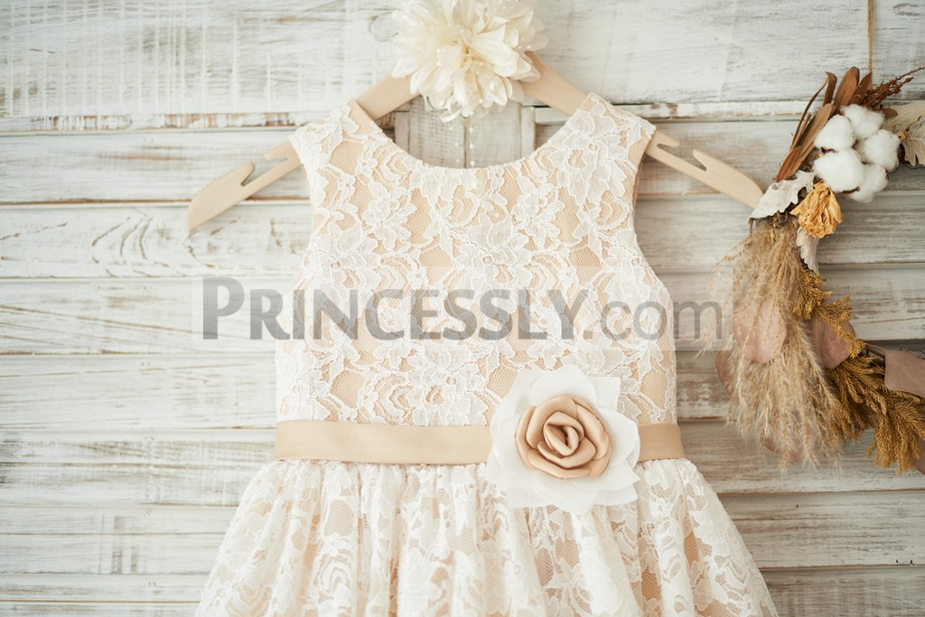 Scoop neckline sleeveless ivory lace champange lining bodice with champagne belt / flower
