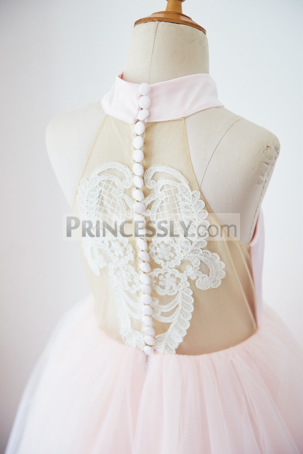 Sheer back closed by cloth buttons with ivory lace appliques