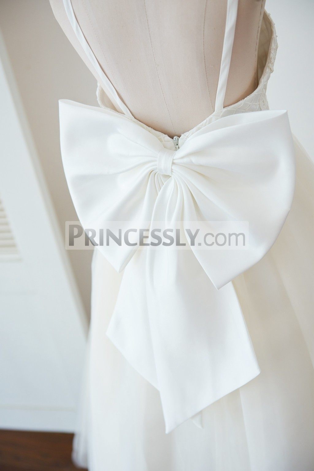 Backless with a big bow on hidden zipper closure