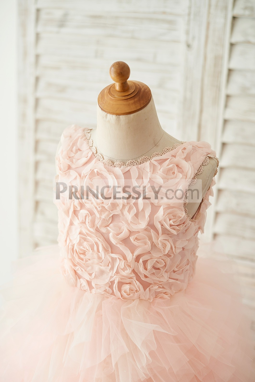 Rosette bodice with scalloped lace jewel neck, sleeveless