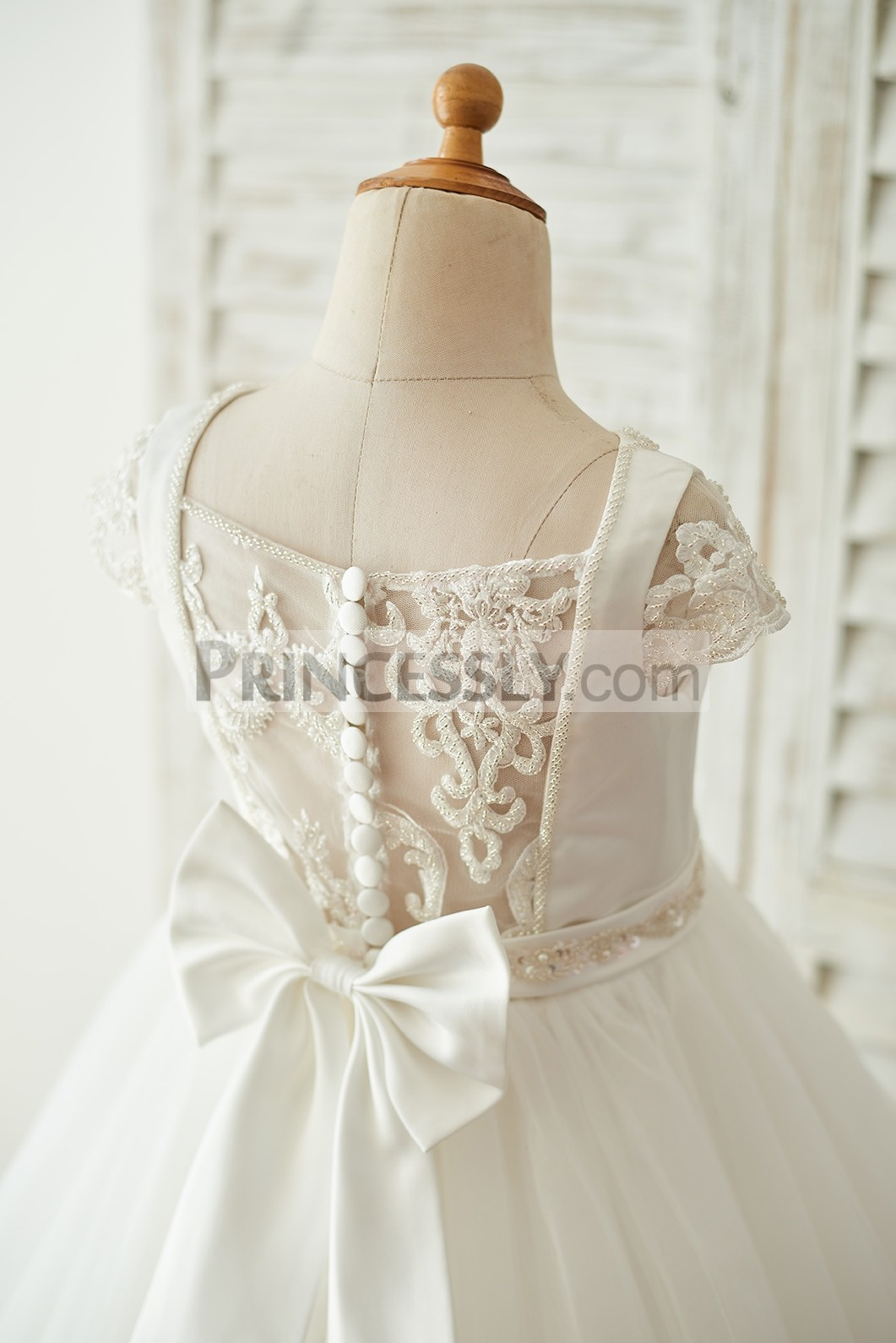 Straight neck sheer lace back with button closure & bow