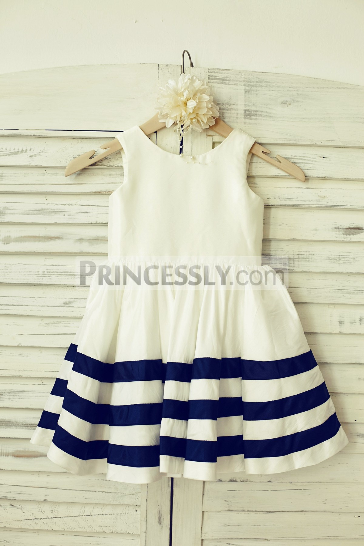 Ivory taffeta flower girl dress with navy blue stripes on skirt