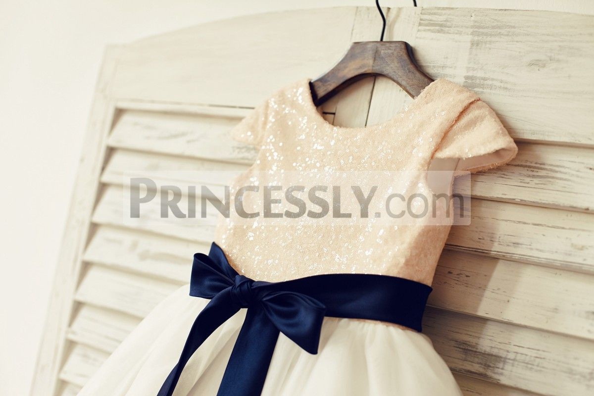 Blush pink sequined bodice with navy blue sash