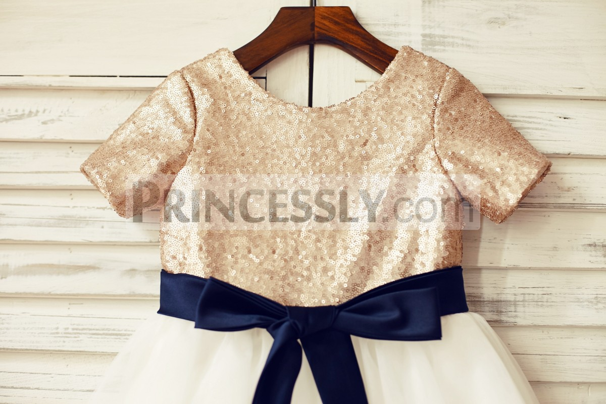 Short sleeves champagne sequined bodice with navy blue sash