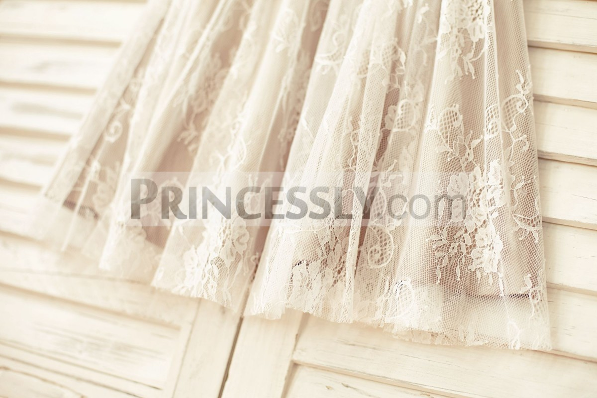 Ivory lace stick out of brown satin lining skirt