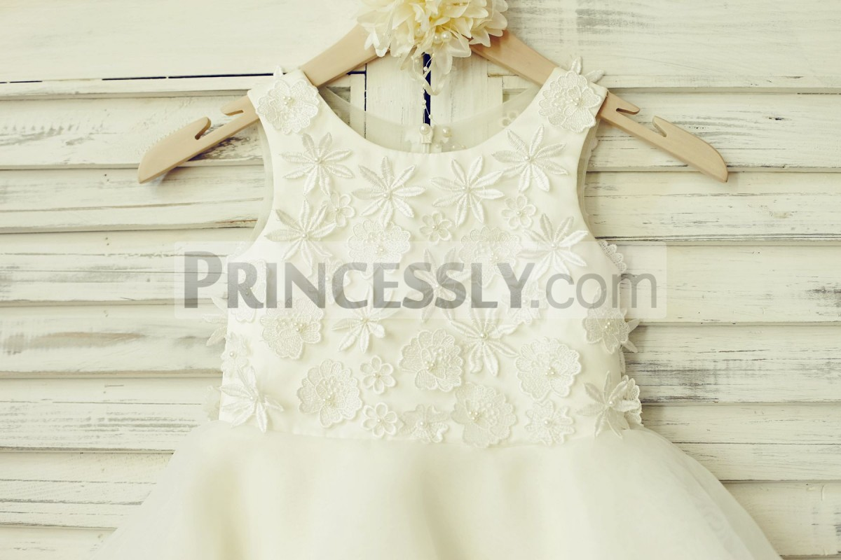 Ivory lace appliques with pearls in the middle