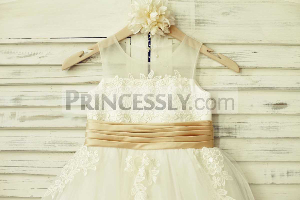 Illusion neck lined bodice with pleated champagne belt