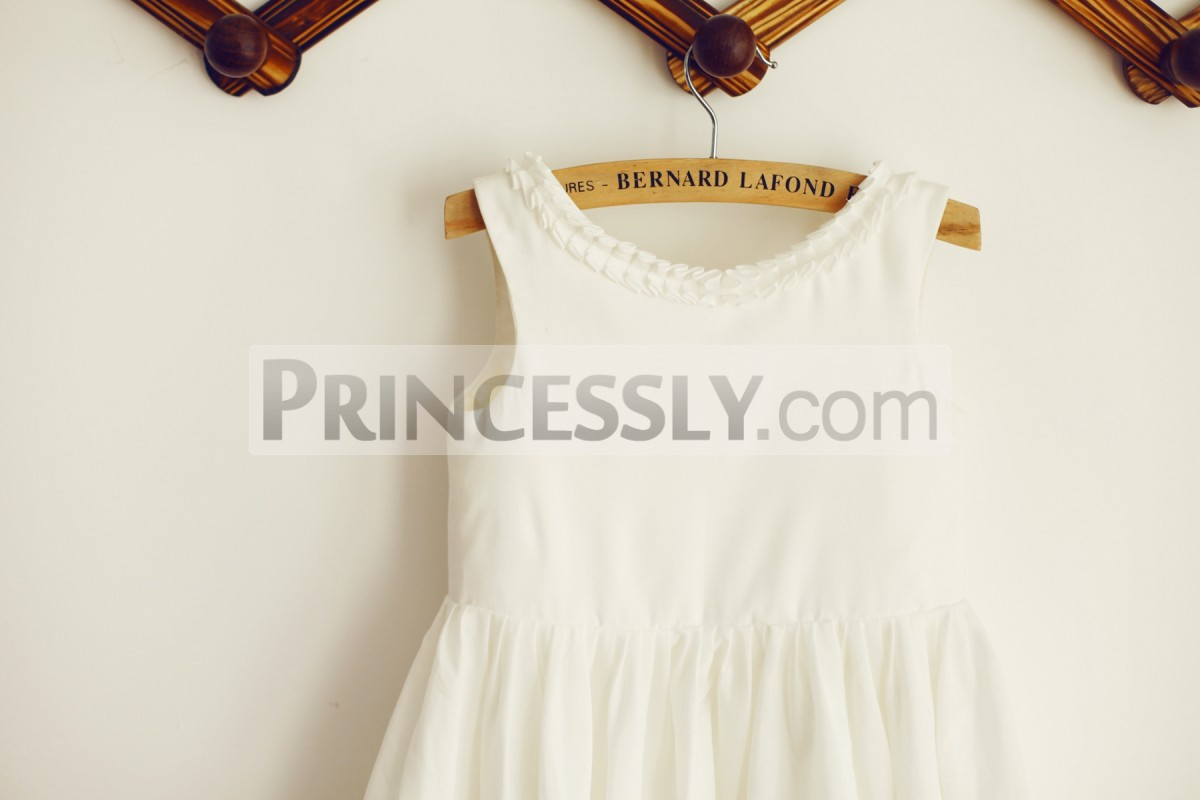 Simple ivory bodice with ruffled scoop neckline