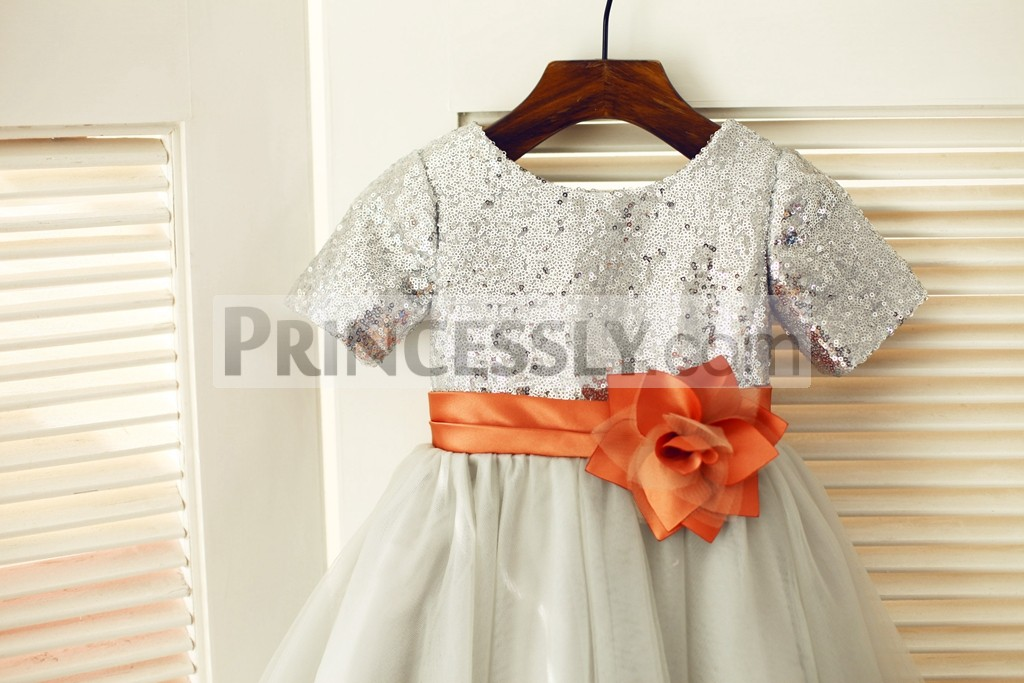 Short sleeves silver sequined bodice with orange belt \ flower