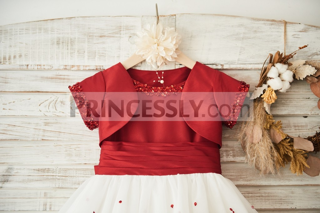 Red beads along neckline, short sleeves holes