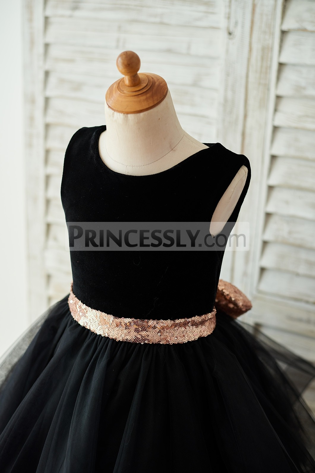 Black velvet bodice with gold sequined belt and bow