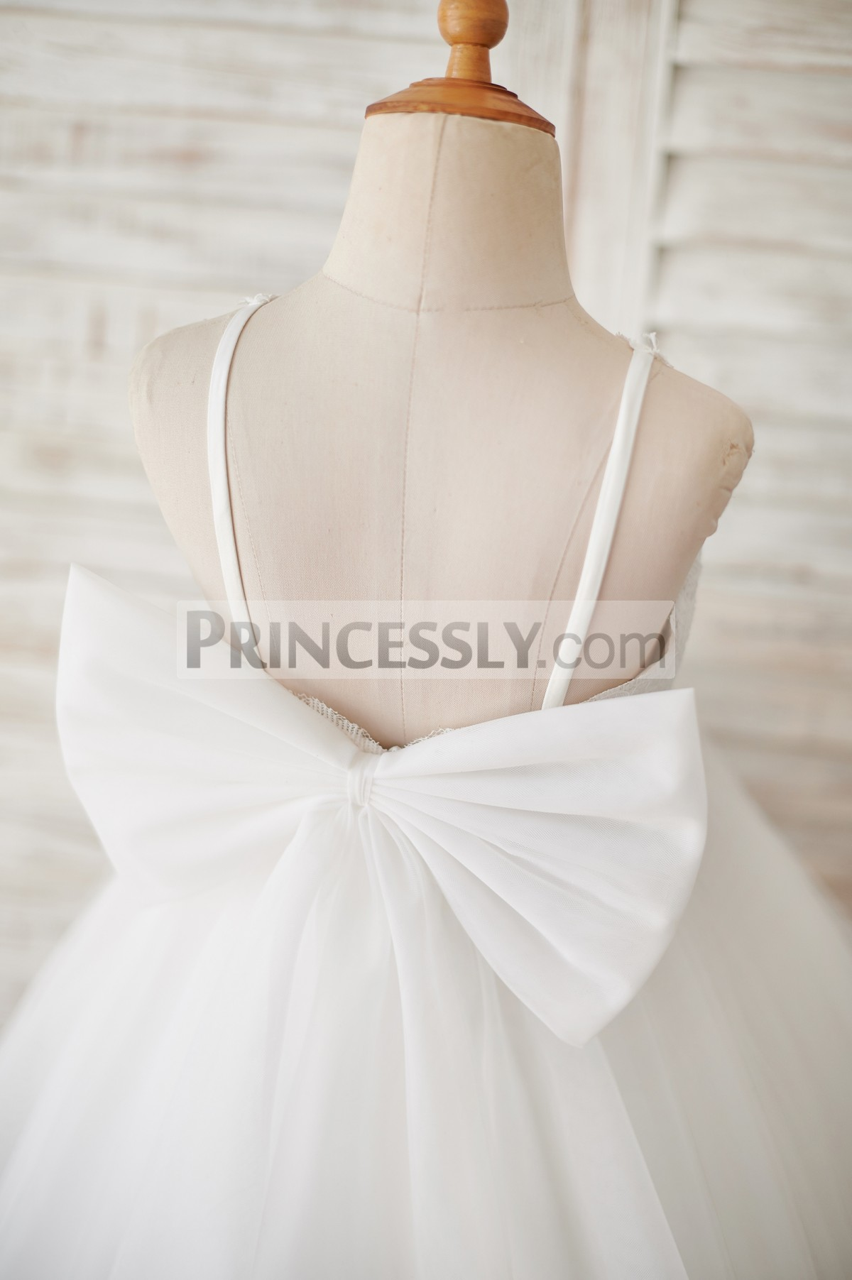 Backless style with a big ivory organza bow